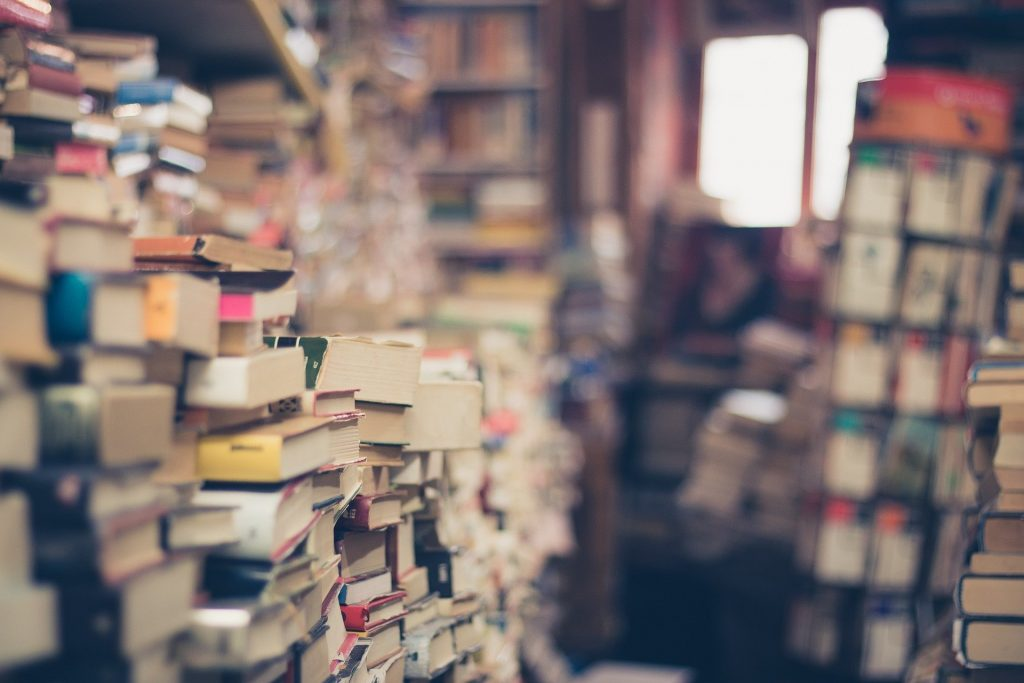 Books piled up and crammed into a room or library